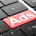 Werbungs Knopf auf einer Tastatur