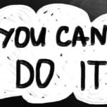 """""""You can do it"""" handwritten with white chalk on a blackboard."""