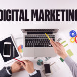 Business team working on desk with a single word DIGITAL MARKETING