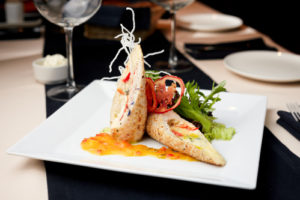 Stuffed chicken fillet with cheese trio, kumquat sauce and nutty rice