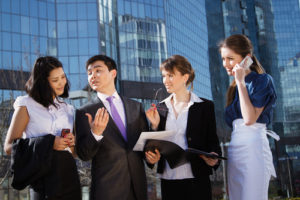 Group of business people meeting outdoor in front of office building