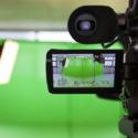 HD Fernsehkamera die auf einen Green screen zeigt