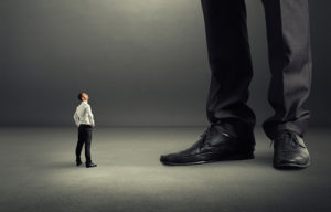 small businessman looking at his big boss