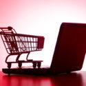 Silhoette von einem Laptop und einem Einkaufswagen
