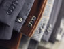 Detail of men's jackets' line in a shop, DOF