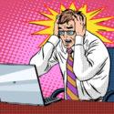 Geschäftsmann, arbeitet am Laptop schlechte Nachrichten Panik