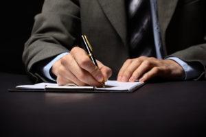 Businessman's Hand mit Stift