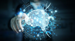 Hand zeigt auf Hologramm mit dem Symbol für künstliche Intelligenz