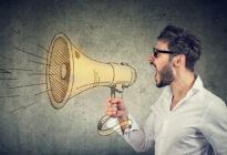 Mann mit Megaphone: Marketing-Schrei