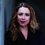 Porträtfoto von Iris Zeppezauer, Coach